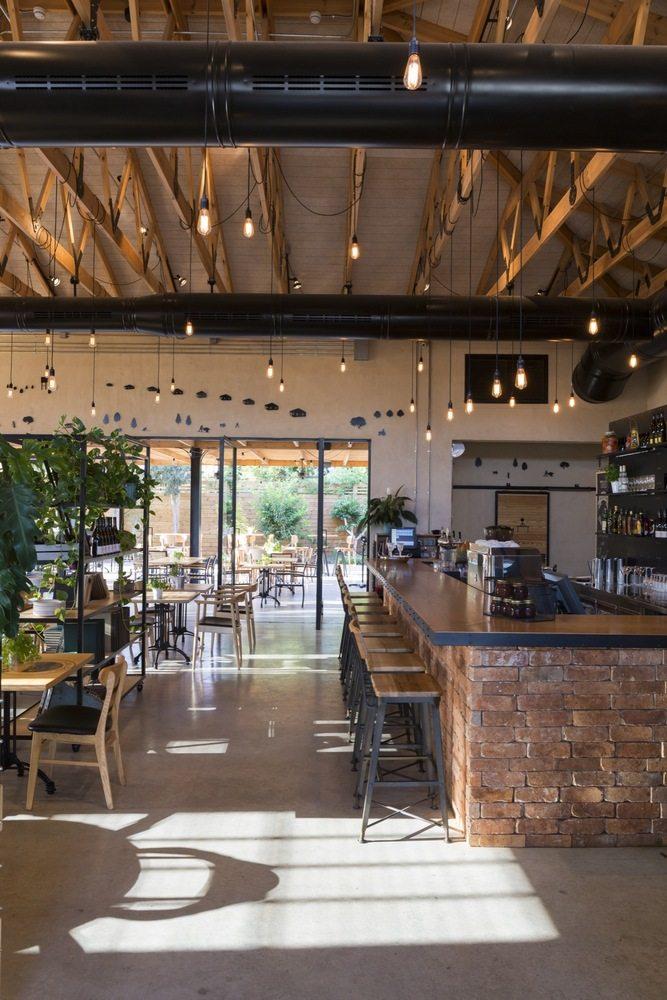以色列kofinas文献馆和餐厅工业风格室内设计实景图